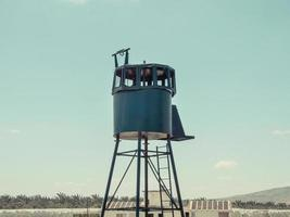 An old army guard metallic watchtower photo