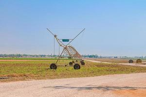 Center pivot sprinkler system in an agricultural field photo