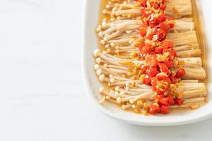 steamed golden needle mushroom or enokitake with soy sauce, chilli and garlic photo