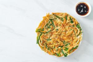 Pajeon or Korean pancake or Korean pizza photo