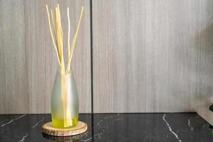 Aromatic reed freshener on table photo