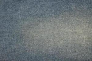 Top view old blue jeans background photo