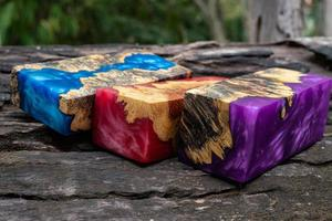 Casting epoxy resin burl wood cube on old table art background photo