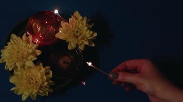 Diwali Indian holiday. Woman lights a diya oil lamp video