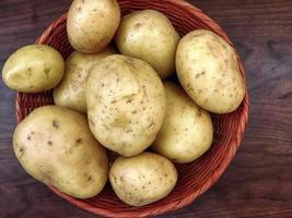 Potatoes on wooden background video