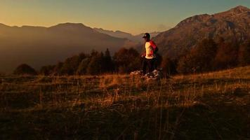 Runner trains freely at sunset in the mountains video
