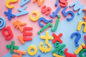 colorful plastic letters on color background, Top view photo