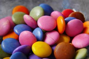 multi-colored sweet candies in a bowl close up photo
