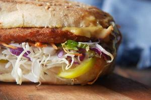 detail shot of club sandwich on wooden table photo