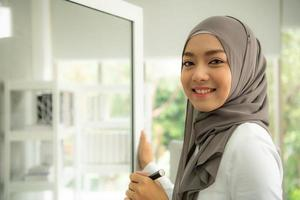 Arabic businesswoman wearing hijab Work in the office photo