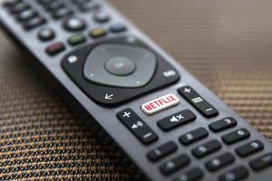 BELGRADE, SERBIA, MAY 9, 2019, Close up Netflix remote control. Netflix is an American media-services provider headquartered in Los Gatos, California, founded in 1997 photo