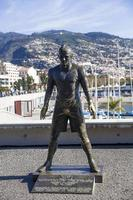 FUNCHAL, PORTUGAL, FEBRUARY 9, 2020, Christiano Ronaldo Statue in Funchal at Madeira Island, Portugal. Statue of famous Madeiran football player was created by sculptor Ricardo Velosa in 2014. photo
