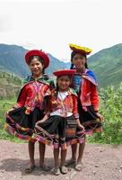PISAC, PERU, MARCH 2, 2006 - Unidentified children at Mirador Taray near Pisac in Peru. Mirador Taray is a scenic vista along the highway overlooking Sacred Valley of the Incas. photo