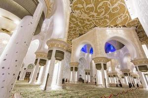 ABU DHABI, UAE, MAY 4, 2015 - Interior of Sheikh Zayed Mosque in Abu Dhabi. Mosque was designed by Yusef Abdelki and opened at 2007. photo