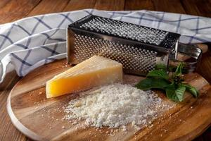 freshly grated chesse on wooden table photo
