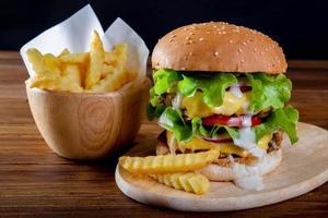 Hamburger homemade on wooden table photo