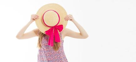 Beautiful slim girl hide her face behind a summer hat isolated on white background copy space. photo