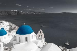 Selective color image, orange color with black and white process. Night lights over Oia village in Santorini, Greece. Famous travel destination, artistic fine art template. Relax, inspire cityscape photo