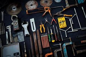 Photo top view a huge set collection of working hand and power tools many for the wooden on isolated black background