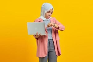 Portrait of young asian woman worried work deadline stress on yellow background photo