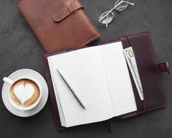 Leather notebooks and cup of coffee photo