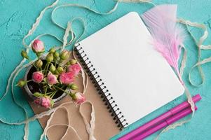Blank notebook on wooden photo