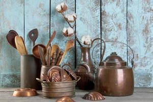 Vintage copper kitchen utensils on a wooden blue background. photo