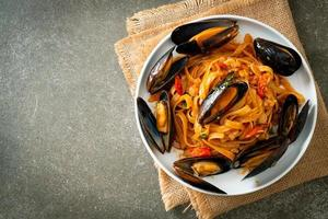 Spaghetti pasta with mussels or clams and tomato sauce photo