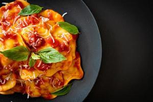 Ravioli with tomato sauce and basil photo