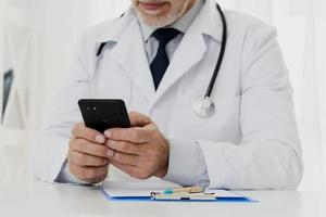 doctor using his phone photo