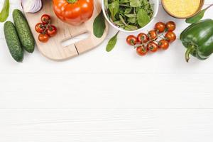 elevated view fresh vegetables white wooden desk photo