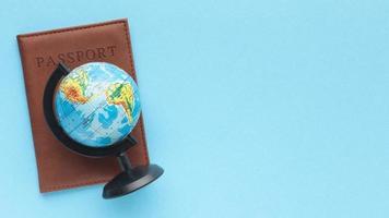 flat lay passport world globe photo
