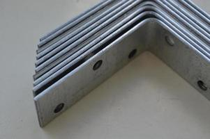 Metal fastening of wooden building structures photo