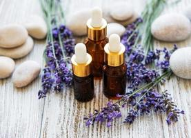 Lavender oil and lavender flowers photo