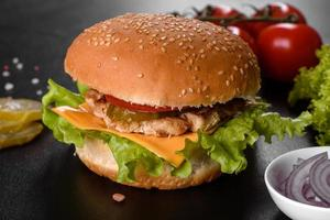 Delicious fresh burger grill with a bun, cheese and meat photo