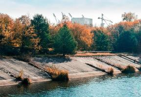 Pripyat, Ukraine, 2021 - Chernobyl forest overtaking buildings photo