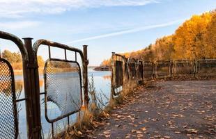 Pripyat, Ukraine, 2021 - Fence near water in Chernobyl photo