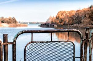 Pripyat, Ukraine, 2021 - Fence near river in Chernobyl photo