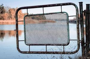 Pripyat, Ukraine, 2021 -Iron fence and river in Chernobyl photo