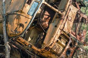 Pripyat, Ukraine, 2021 - Abandoned vehicle in the Chernobyl forest photo