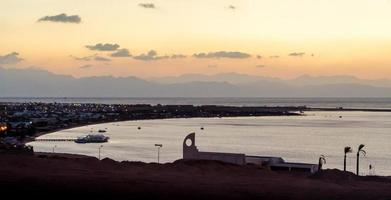 sunrise landscape Red Sea coast with silhouette of high mountains and sky with clouds in Egypt photo