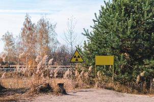 Pripyat, Ukraine, 2021 - Radioactive contamination sign in a forest in Chernobyl photo
