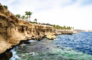Sharm El Sheikh, Egypt, 2021 - Rocky beach and a reef on the Red Sea coast photo