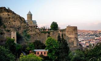 Georgia, 2021 - People visiting a church on a mountain photo