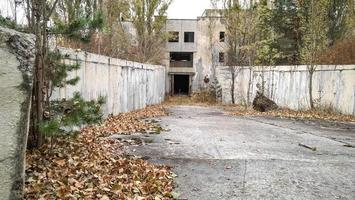 Pripyat, Ukraine, 2021 - Old white abandoned building in Chernobyl photo