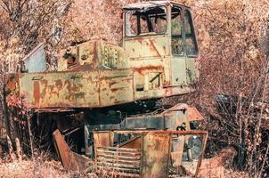 Pripyat, Ukraine, 2021 - Abandoned equipment in the Chernobyl forest photo