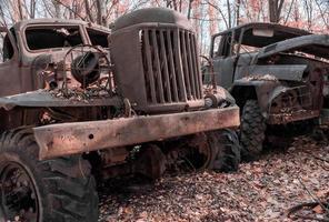 Pripyat, Ukraine, 2021 - Two abandoned rusty army trucks Chernobyl photo