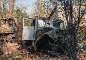 old abandoned wrecked vehicle in Chernobyl photo