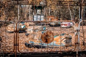 Pripyat, Ukraine, 2021 - Dilapidated amusement park rides in Chernobyl photo