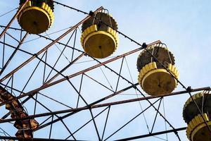 Pripyat, Ukraine, 2021 - Carousel cabins in an abandoned amusement park in Chernobyl photo